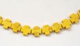 HOWLIT - korálek kříž žlutý 1 ks